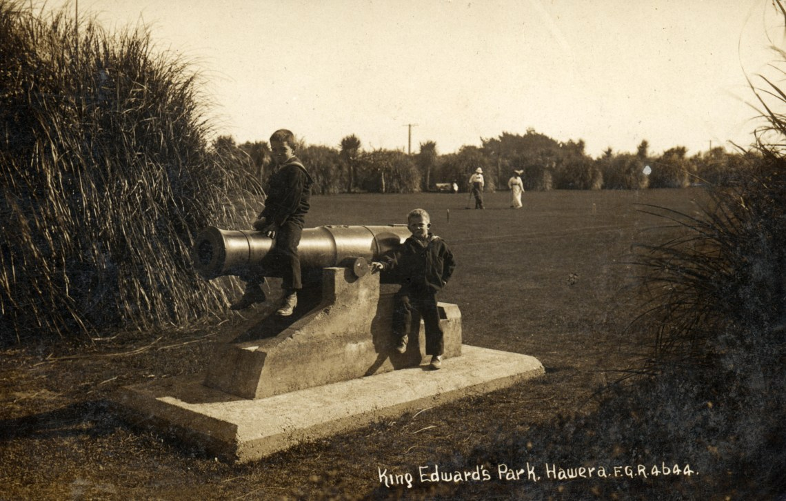 children-playing-on-a-cannon-in-king-edward-park-hawera-photographer-frederick-george-radcliffe-2002-101