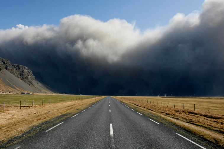 Volcanic ash clouds pour over Iceland´s main ring road near Skogar, east of the eruption. ( AP Photo/Brynjar Gauti )